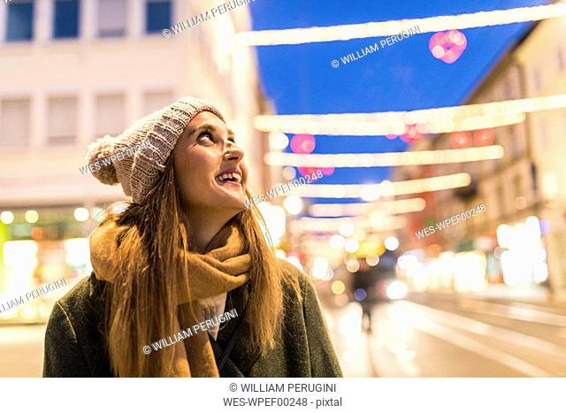 Content young woman on the street at Christmas time