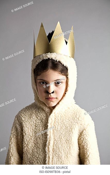 Young girl dressed up as sheep, wearing gold crown