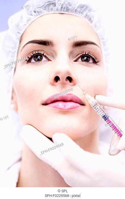 Woman having injection in face