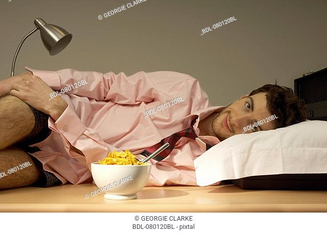 businessman resting on his desk