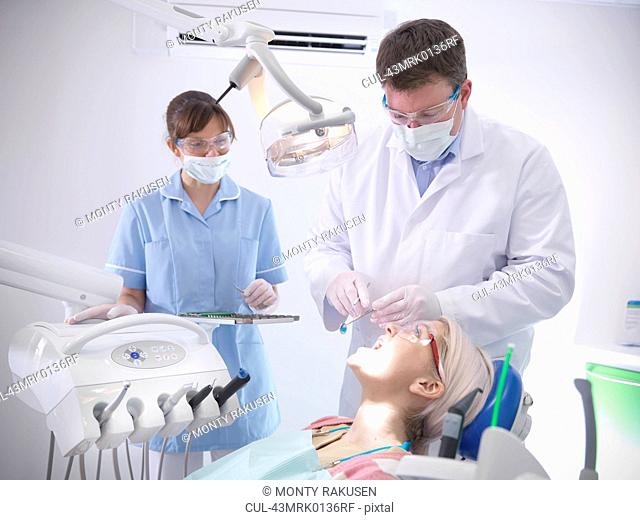 Dental student and dentist in surgery