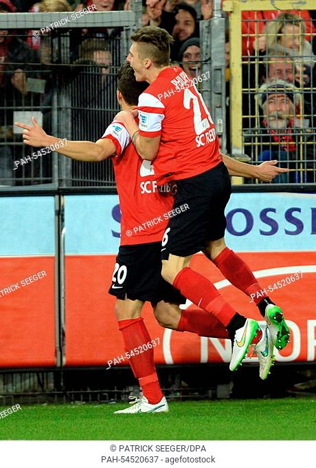 Freiburg's Marc-Oliver Kempf celebrates the 2-0 goal with Maximilian Philipp (R) during the German Bundesliga soccer match between SC Freiburg and Hannover 96...