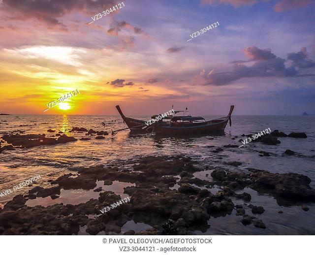 Sunset and Boat at Koh Bulone island, Panka Yai beach, Satun, Thailand
