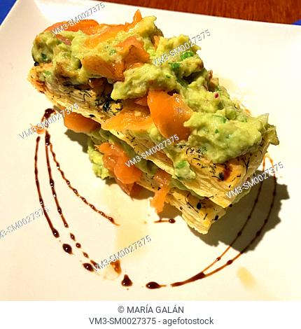 Puff pastry made of smoked salmon and avocado