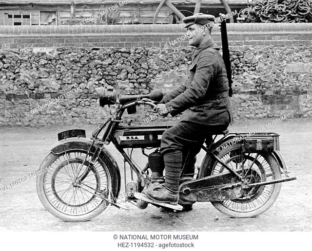 1918 500cc BSA WD motorcycle, (c1918?). A soldier is riding the machine, his rifle over his shoulder