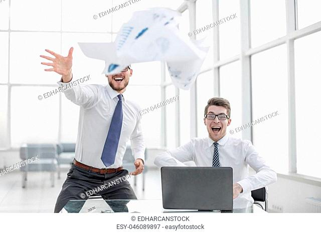 happy colleagues throwing business papers.the concept of a successful startup