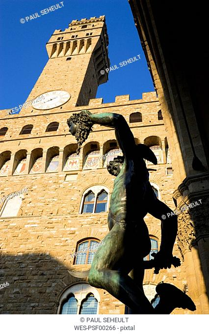 Italy, Tuscany, Florence, Palazzo Vecchio, Statue in foreground, low angle view