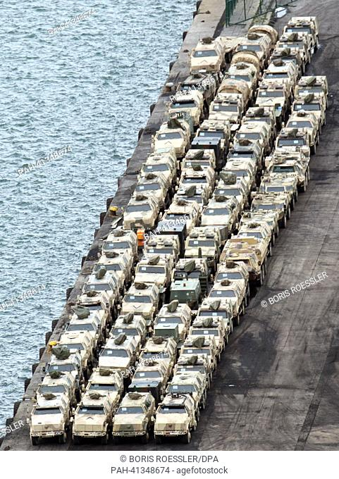 Heavy military vehicles are prepared for shipment by logistics personell of the German Bundeswehr at the harbour of Trabzon, Turkey, 28 July 2013