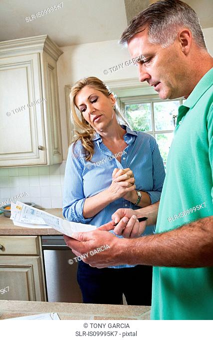 Mature couple looking at household bills