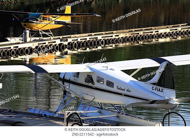DeHavilland Beaver and Cessna floatplanes tied up at dock, Seal Cove, Prince Rupert, British Columbia