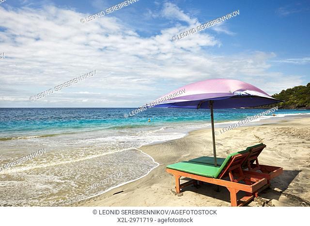 Sun beds and umbrella for rent on White Sand Beach (Pantai Bias Putih). Manggis subdistrict, Karangasem Regency, Bali, Indonesia