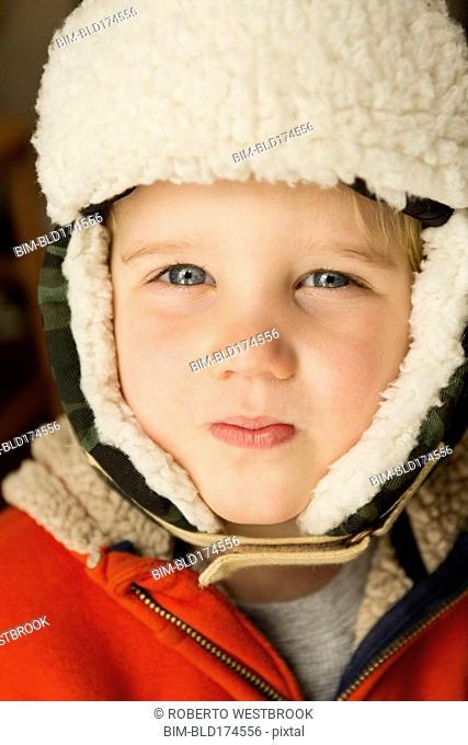 Caucasian boy wearing warm hat