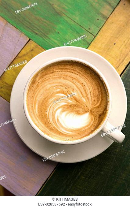 Two Cups of coffee with latte art on wooden table,top view