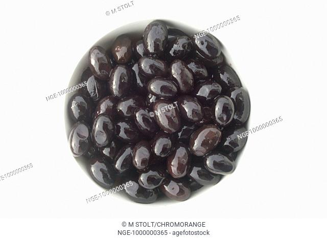 A dish with black olives