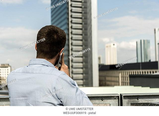Young man in the city talking on the phone