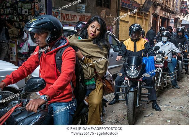 Motorcycle commuters caught in a traffic jam in Kathmandu