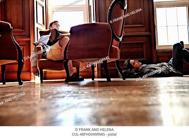 Men napping in ornate room