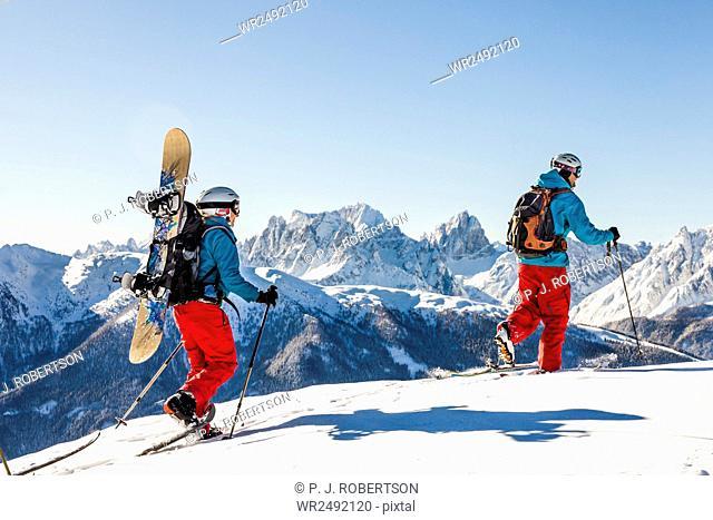 Ski tourers walking in Sexten Dolomites