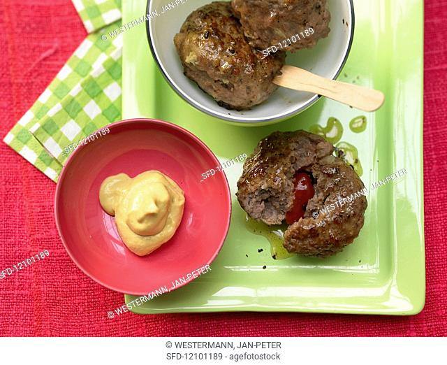 Stuffed meatballs with mustard or ketchup