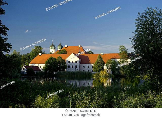 Seeon Abbey reflecting in the lake, Seeon, Chiemgau, Bavaria, Germany