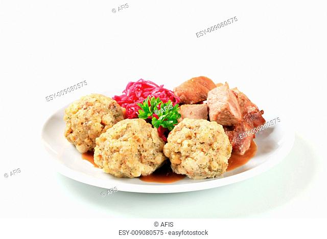Roast pork with Tyrolean dumplings and red cabbage