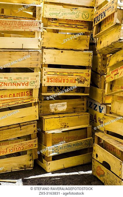Pile of empty wooden crates in Campo de Fiori market - Rome, Italy