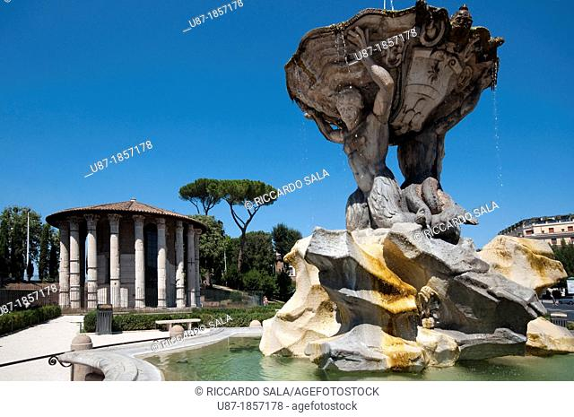 Italy, Lazio, Rome, Bocca della Verità Square, Triton Fountain by Bizzaccheri background Temple di Vesta or Hercules Temple