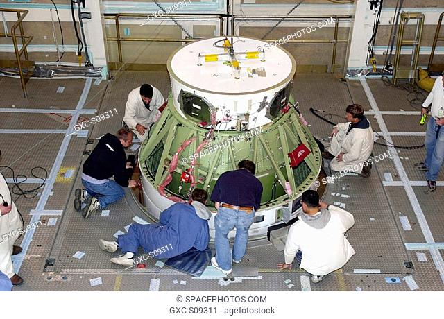 03/01/2002 --- VANDENBERG AFB, CALIF. - - Inside the gantry on the SLC-2 launch pad, workers check the fitting on the second stage of a Delta II rocket mated...