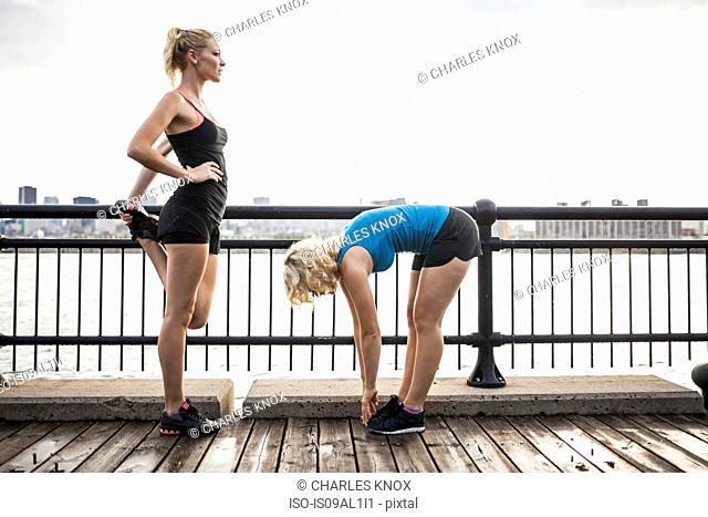 Women stretching on bridge, Montreal, Quebec, Canada
