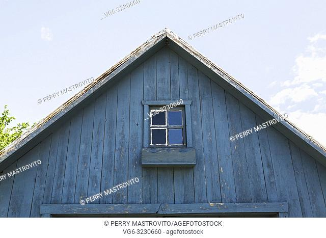 Old rustic blue painted wooden barn-garage facade