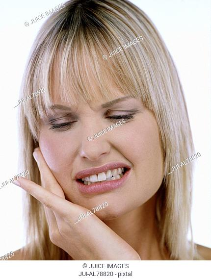 Studio shot of woman with jaw pain