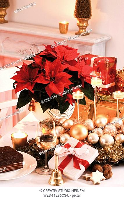 Christmas decoration and christmas presents on table