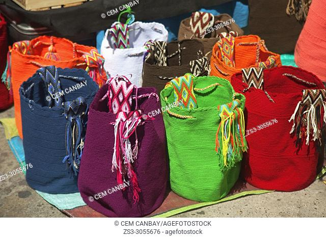 Colorful bags in the open-air Art and Craft market at the historic center, Cartagena de Indias, Bolivar, Colombia, South America