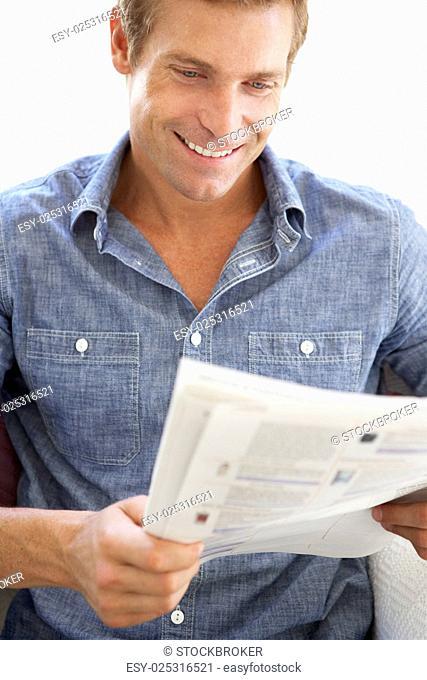 Man reading instruction book