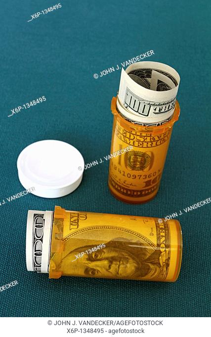 Symbolic presentation of the high cost of prescription medication  US $100 bills in pill containers