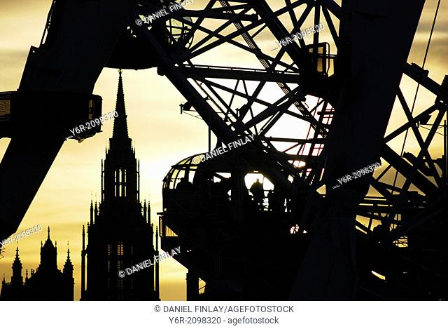 The London Eye seen against a sunset, in the heart of London, England, on a Winters evening