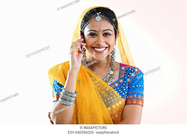 Gujarati woman talking on a mobile phone