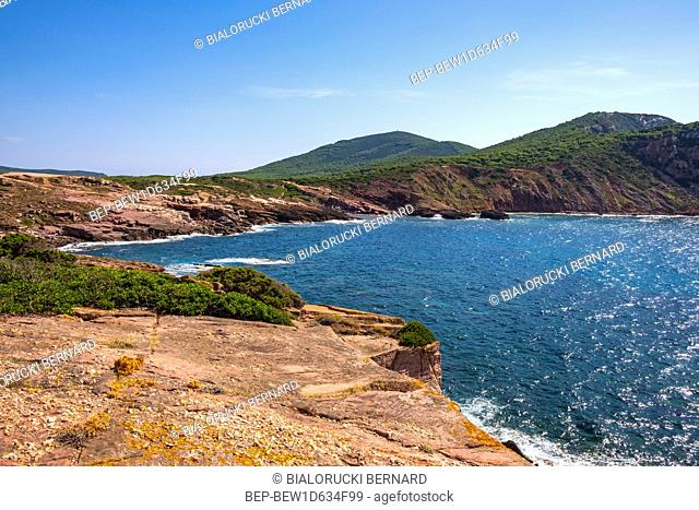 Alghero, Sardinia / Italy - 2018/08/11: Panoramic view of the Cala Porticciolo gulf with cliffs over the Cala Viola gulf in the Porto Conte Regional Park
