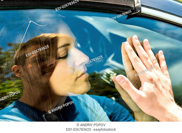 Couple Saying Goodbye Before Car Travel Through The Car Window