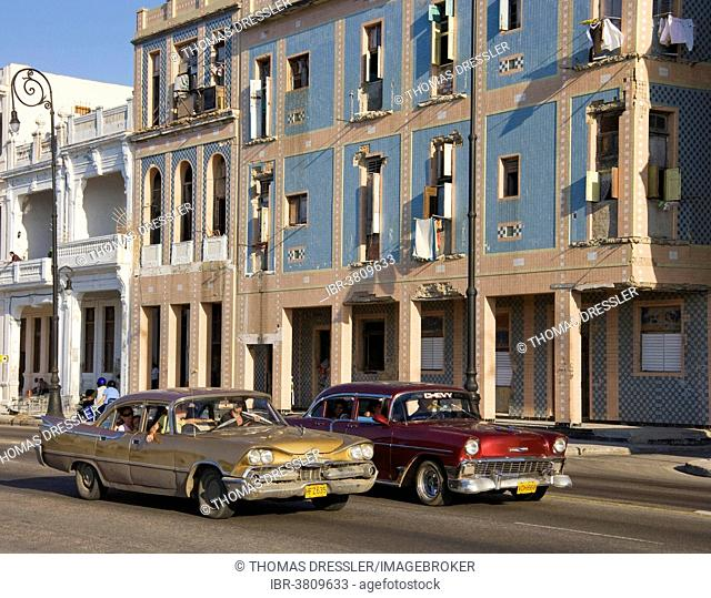 A Dodge, on the left, and a Chevrolet driving on the Malecón esplanade, classic cars, Havana, Cuba