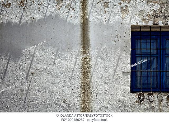 White wall and white window with bars  Fisherman's house in La Isleta del Moro, Parque Natural del Cabo de Gata, Andalusia, Spain