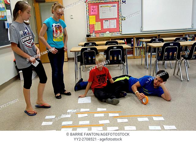 6th Graders Solving Math Problem With Manipulatives, Wellsville, New York, USA