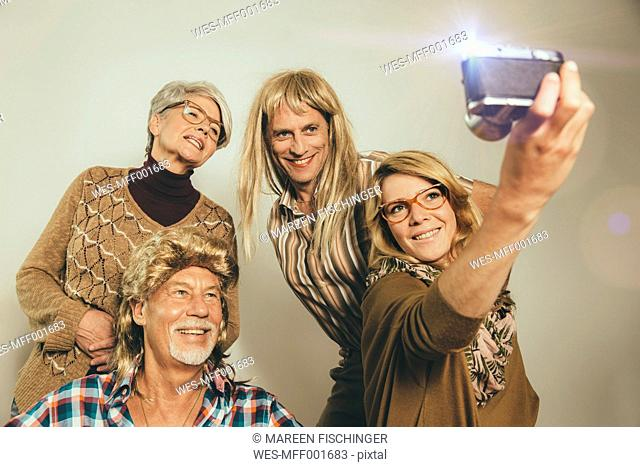 Family dressed like in the Eighties taking a selfie