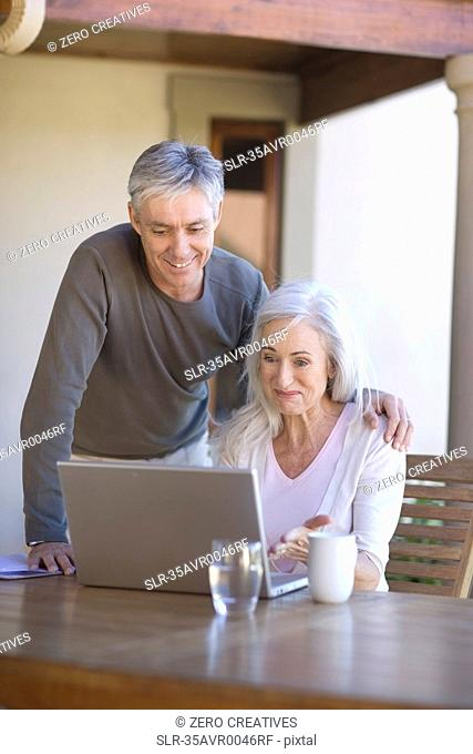 Older couple using laptop together