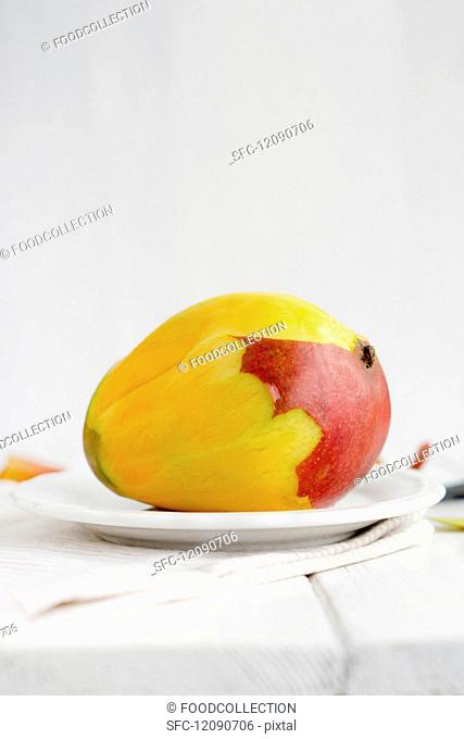 A peeled mango on a plate