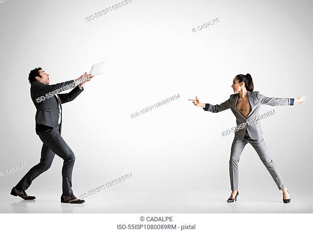 Woman throwing digital table to man