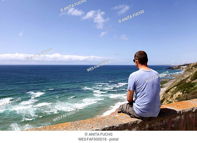 Portugal, Sintra, man looking to the ocean