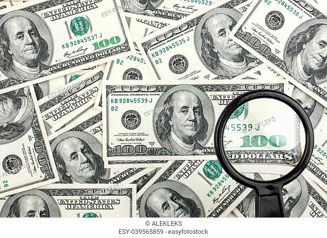 Look through a magnifying glass on the money can be used as background