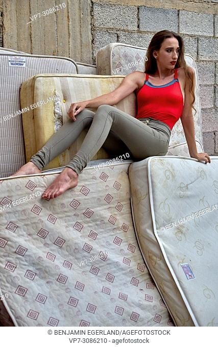 model woman sitting on mattresses