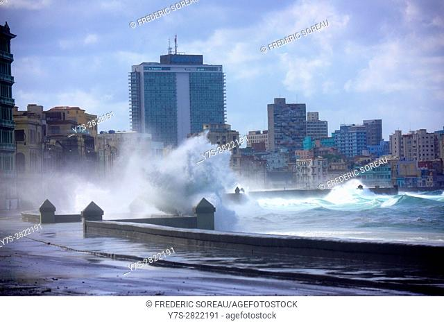 Waves splashing towards retaining wall against cloudy sky, Havana, Cuba